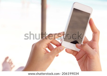 Woman Using a Smart Phone - stock photo