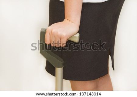 woman using a three point cane ,walking aid for gait training - stock photo