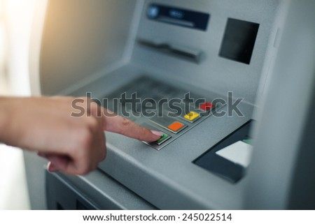 Woman using banking machine. Close up - stock photo