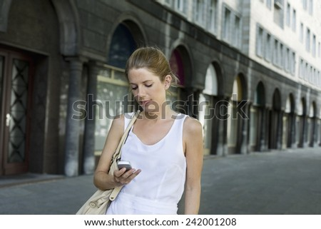 Woman Using Cell Phone - stock photo