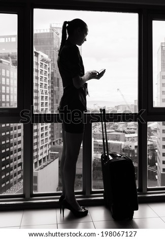 Woman using cellphone mobile at the airport. Travel concept.