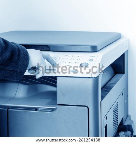 woman using copy machine - stock photo