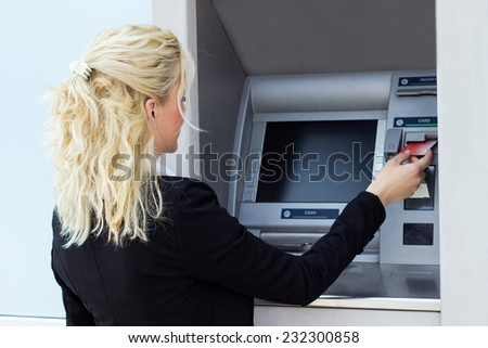 Woman using credit card - stock photo