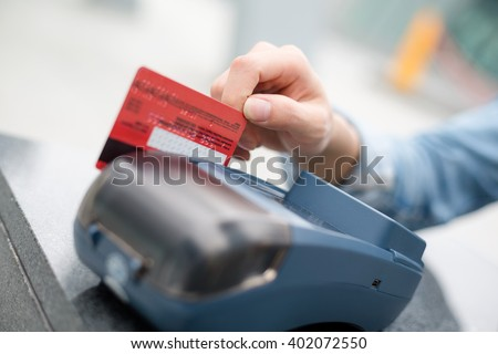 Woman using credit card to pay  - stock photo