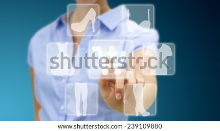 Woman using digital interface to shop online
