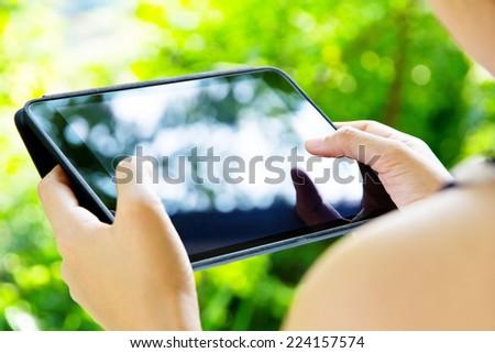 Woman using digital tablet - stock photo