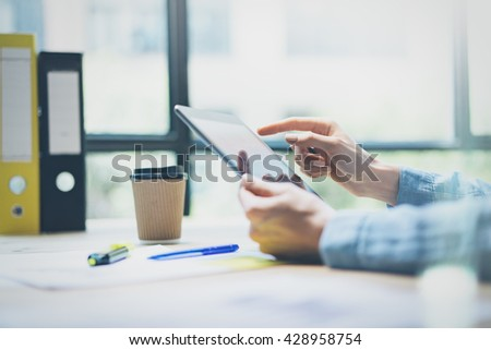Woman Using Digital Tablet Hand.Production producer brainstorming modern office.Reflections Screen.Young Business Crew Working with New Startup Studio. Blurred,film effect. Horizontal - stock photo