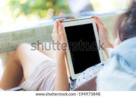 Woman using digital tablet PC - stock photo