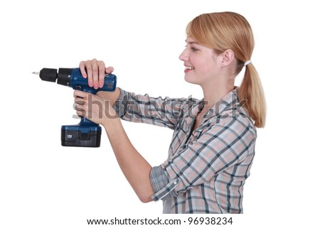 Woman using drill - stock photo
