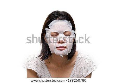 Woman using  facial mask