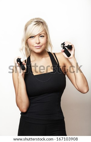 woman using hand grips in her work out