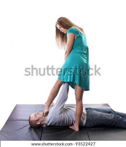 Woman using her Judo skills to overpower an attacker - stock photo