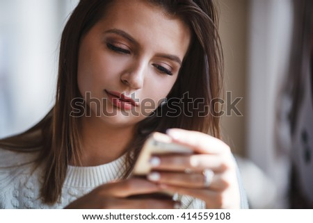 woman using her mobile phone at cafe - stock photo