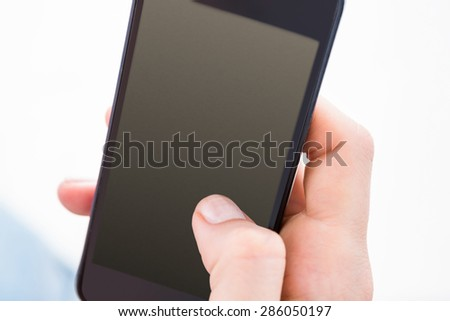 Woman using her mobile phone on white background