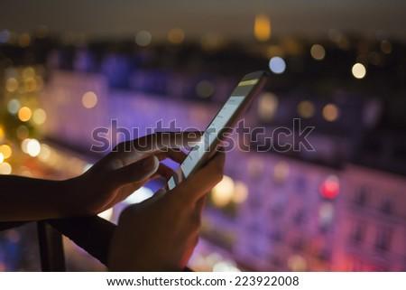 Woman using her smart phone , city skyline night light  background - stock photo