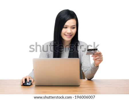 Woman using laptop computer for online shopping