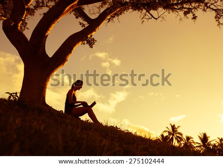 Woman using laptop in the park - stock photo