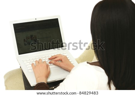 Woman using laptop on sofa isolated