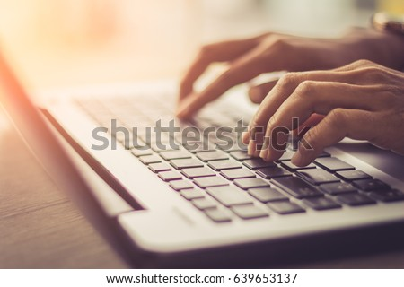 woman using laptop, searching web, browsing information, having workplace at home  / soft focus picture / Vintage concept
