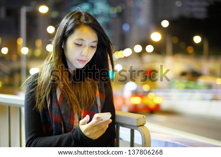 woman using mobile at night - stock photo