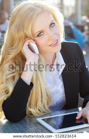 woman using mobile phone and digital tablet