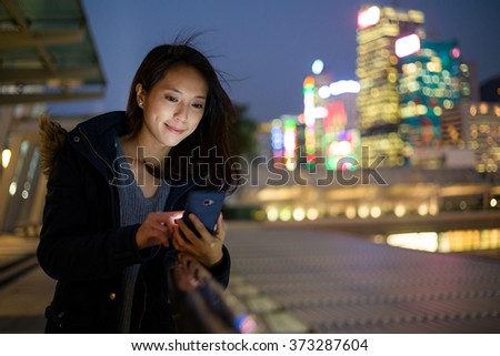 Woman Using mobile phone at night  - stock photo