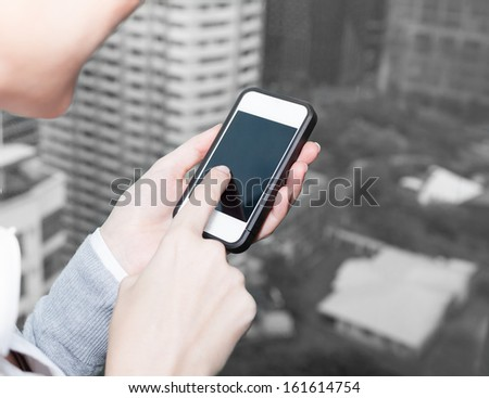 Woman using mobile smart phone - stock photo