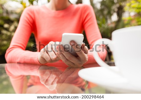 Woman using mobile smart phone. - stock photo