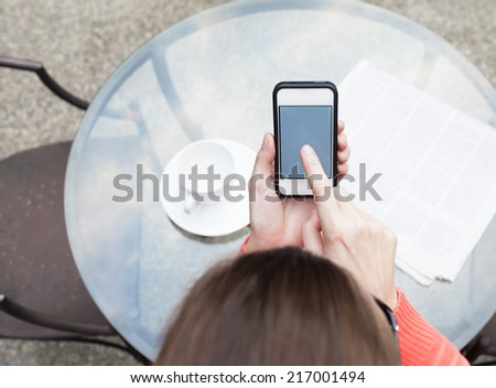Woman using mobile smart phone outdoors - stock photo