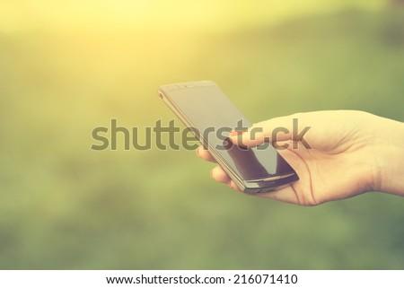 Woman using smart phone - stock photo