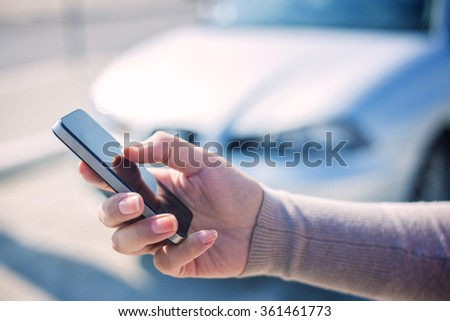 Woman using smart phone and call the car insurance