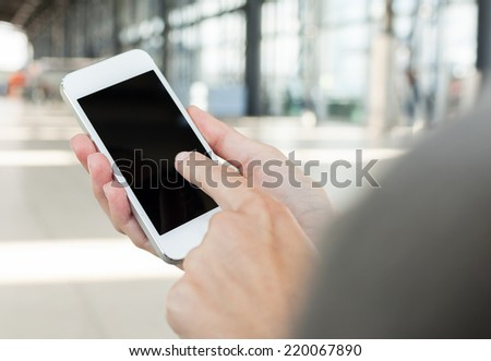 Woman using smart phone mobile in the airport terminal - stock photo
