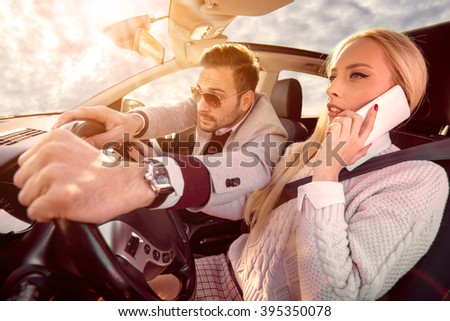 Woman using smart phone while driving a car.Dangerous driving. - stock photo