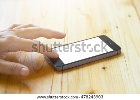 woman using smartphone with blank screen on table background
