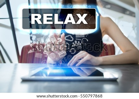 Woman using tablet pc and selecting relax.