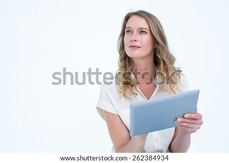 Woman using tablet pc on white background - stock photo