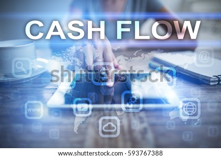 Woman using tablet pc, pressing on virtual screen and selecting cash flow.