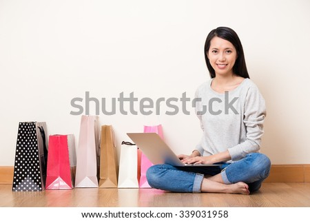 Woman using the notebook computer for shopping online - stock photo
