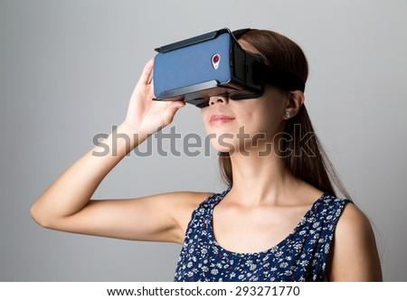 Woman using the virtual reality equipment - stock photo
