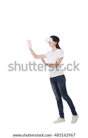 Woman using the virtual reality headset, full length portrait isolated on white