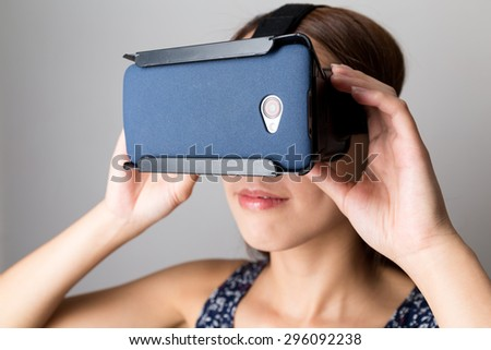 Woman using the VR for watching film - stock photo