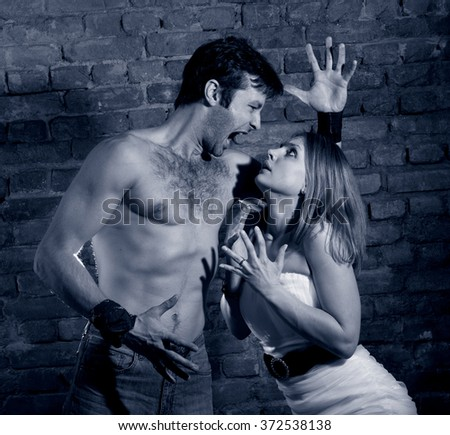 Woman victim of domestic violence. Aggression in the family.Family fights.Family hatred.Heavy men and women.Blue Image - stock photo