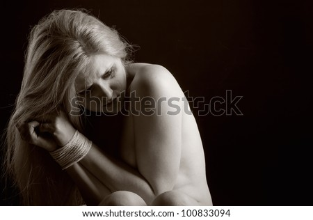 Woman victim of domestic violence and abuse. Black and white photo - stock photo