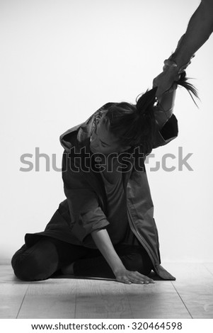 Woman victim of domestic violence and abuse,black and white photo. - stock photo