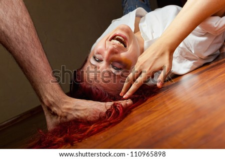 Woman victim of domestic violence and abuse. Husband mocks his wife - stock photo