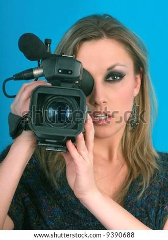 woman  video camera  blue screen - stock photo