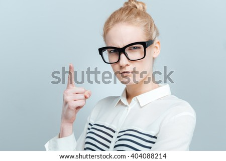 Woman wagging her finger isolated on a white background - stock photo