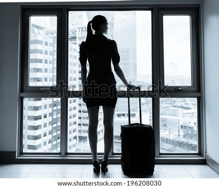 Woman waiting at the airport. - stock photo