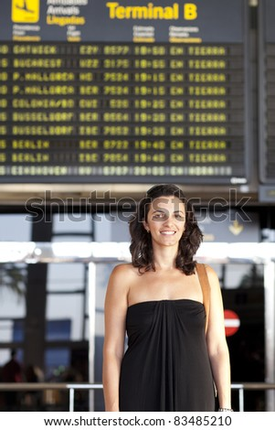 Woman waiting at the airport - stock photo