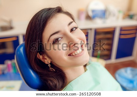 Woman waiting for a dental exam - stock photo